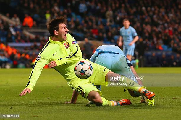 Lionel Messi of Barcelona draws a foul from Pablo Zabaleta of Manchester City in the area to win a penalty during the UEFA Champions League Round of...