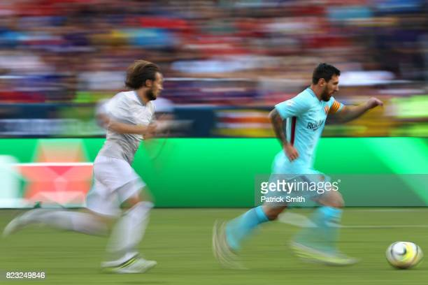 Lionel Messi of Barcelona dribbles against Manchester United in the first half during the International Champions Cup match at FedExField on July 26...