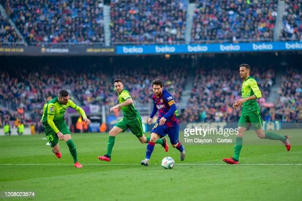 February 22: Lionel Messi of Barcelona dribbles into the penalty box past Anaitz Arbilla of Eibar to score the second of his four goals during the...