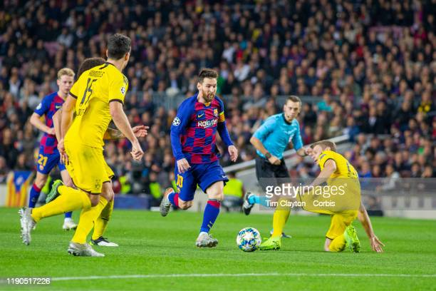 November 27: Lionel Messi of Barcelona dribbles past Lukasz Piszczek of Borussia Dortmund during the Barcelona V Borussia Dortmund, UEFA Champions...