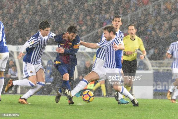 Lionel Messi of Barcelona duels for the ball with Illarramendi and Oyarzabal of Real Sociedad during the Spanish league football match between Real...