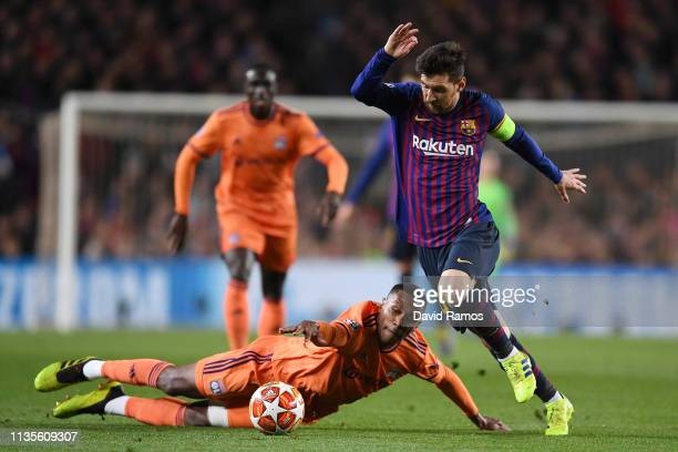 Lionel Messi of Barcelona evades Marcelo of Olympique Lyonnais during the UEFA Champions League Round of 16 Second Leg match between FC Barcelona and...