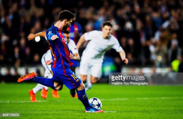 Lionel Messi of Barcelona executes a penalty kick during the UEFA Champions League Round of 16 second leg match between FC Barcelona and Paris...