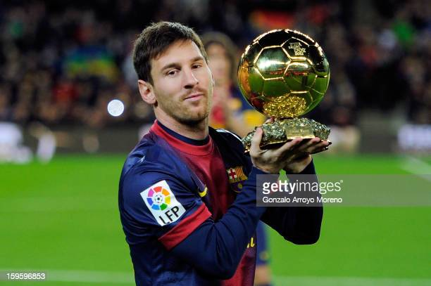 Lionel Messi of Barcelona FC offers his 4th ballon d'or to the audience prior to the Copa del Rey Quarter Final match between Barcelona FC and Malaga...