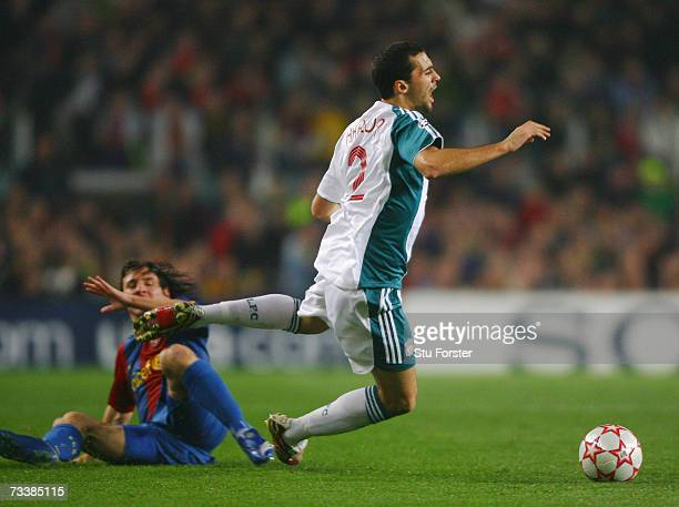 Lionel Messi of Barcelona fouls Liverpool defender Alvaro Arbeloa during the UEFA Champions leagueRound of 16 first leg match between Barcelona and...