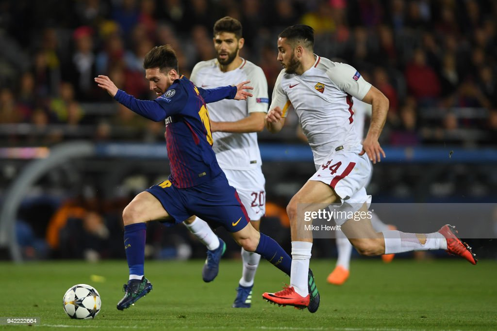 Lionel Messi of Barcelona gets away from Federico Fazio and Konstantinos Manolas of Roma during the UEFA Champions League Quarter Final Leg One between FC Barcelona and AS Roma at Camp Nou on April 4, 2018 in Barcelona, Spain.
