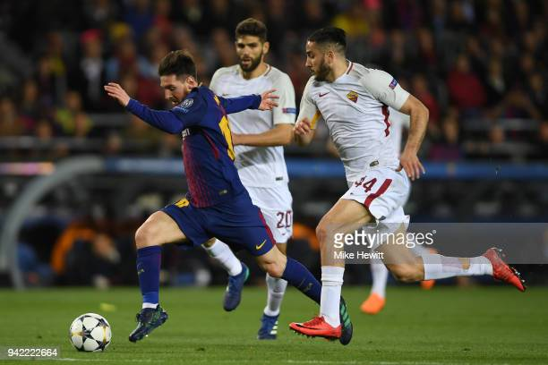 Lionel Messi of Barcelona gets away from Federico Fazio and Konstantinos Manolas of Roma during the UEFA Champions League Quarter Final Leg One...