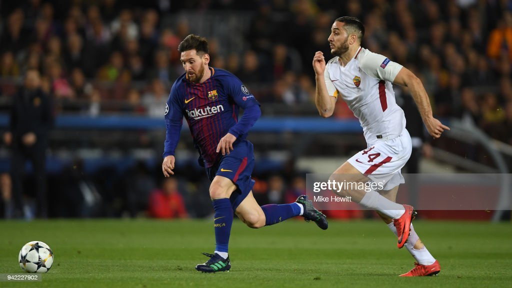 Lionel Messi of Barcelona gets away from Konstantinos Manolas of Roma during the UEFA Champions League Quarter Final Leg One between FC Barcelona and AS Roma at Camp Nou on April 4, 2018 in Barcelona, Spain.
