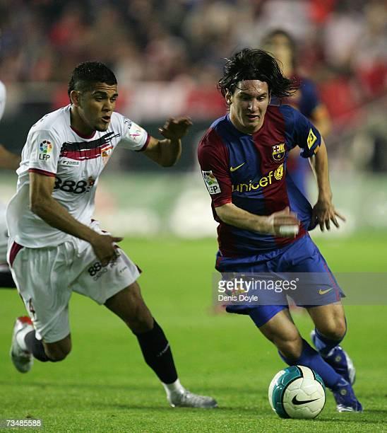 Lionel Messi of Barcelona gets past Daniel Alves of Sevilla during the Primera Liga match between Sevilla and Barcelona at the Sanchez Pizjuan...