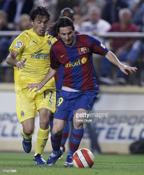 Lionel Messi of Barcelona gets past Javi Venta of Villarreal during the Primera Liga match between Villarreal and Barcelona at the Madrigal stadium...