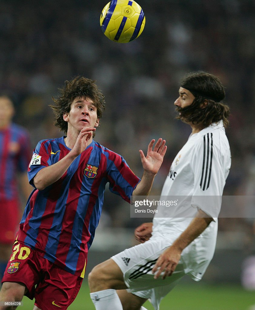 Lionel Messi of Barcelona gets past Pablo Garcia of Real Madrid during a Primera Liga match between Real Madrid and F.C. Barcelona at the Bernabeu on November 19, 2005 in Madrid, Spain.
