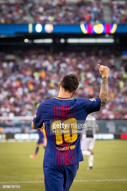 Lionel Messi of Barcelona gives a thumbs during the International Champions Cup match between FC Barcelona and Juventus at the MetLife Stadium on...