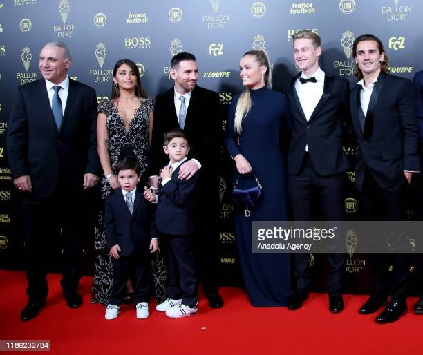 Lionel Messi of Barcelona his wife Antonella Roccuzzo and Antoine Griezmann of Barcelona arrive for the Ballon d'Or ceremony at Theatre du Chatelet...