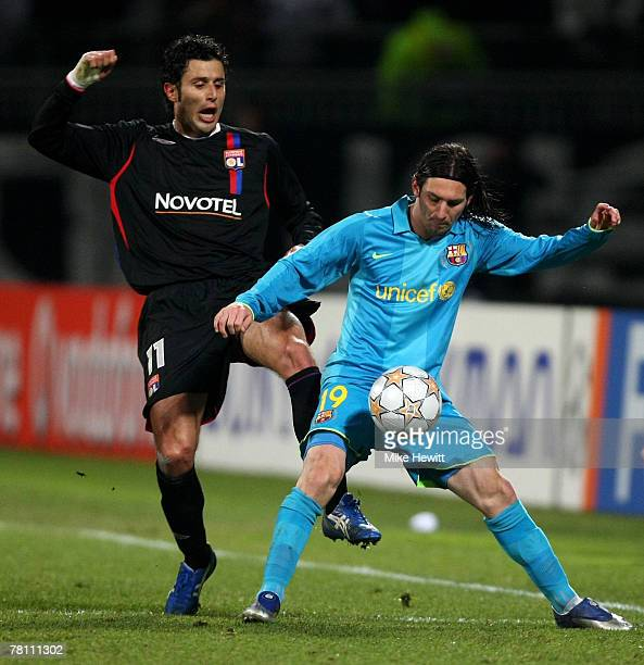 Lionel Messi of Barcelona holds off a challenge from Fabio Grosso of Lyon during the UEFA Champions League Group E match between Lyon and Barcelona...