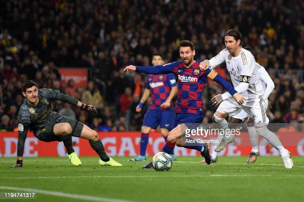 Lionel Messi of Barcelona holds off Sergio Ramos of Real Madrid during the Liga match between FC Barcelona and Real Madrid CF at Camp Nou on December...