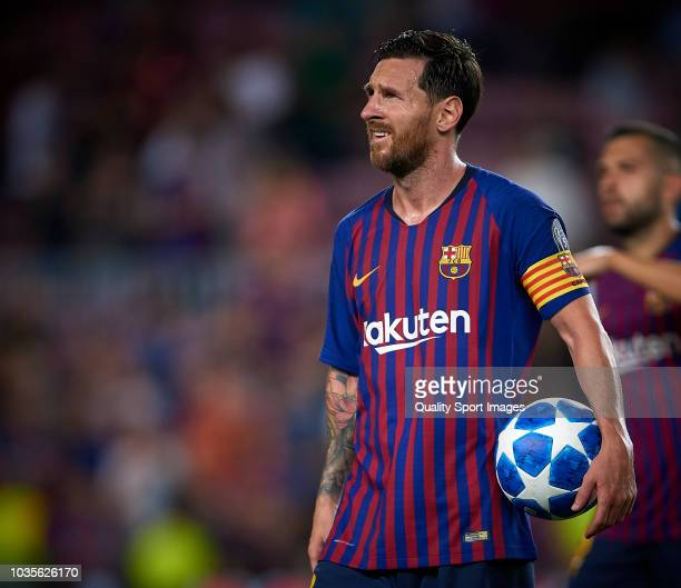 Lionel Messi of Barcelona holds the match ball after scoring a hat-trick during the Group B match of the UEFA Champions League between FC Barcelona...