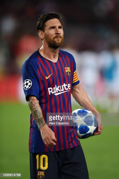 Lionel Messi of Barcelona holds the matchball after scoring a hattrick during the Group B match of the UEFA Champions League between FC Barcelona and...