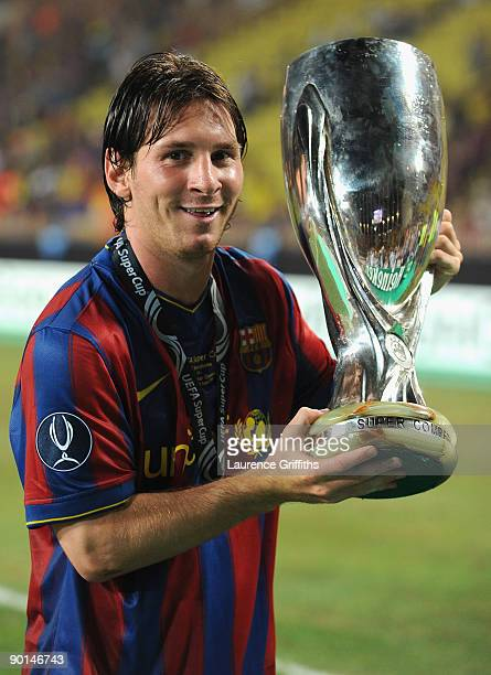 Lionel Messi of Barcelona holds the trophy after defeating the Shakhtar Donetsk at the UEFA Super Cup Final at the Stade Louis II on August 28 2009...