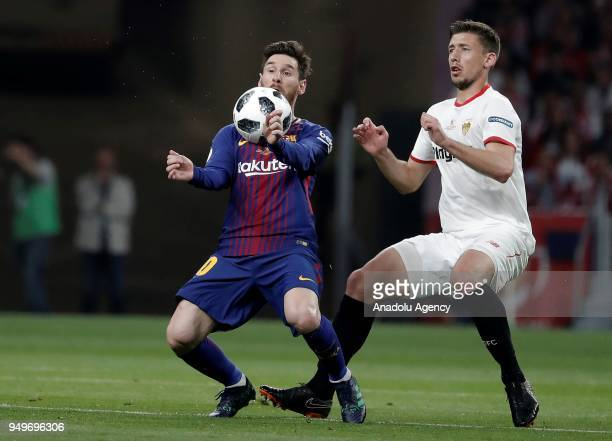 Lionel Messi of Barcelona in action against Clement Lenglet of Sevilla during Copa del Rey Final soccer match between Sevilla and Barcelona at Wanda...