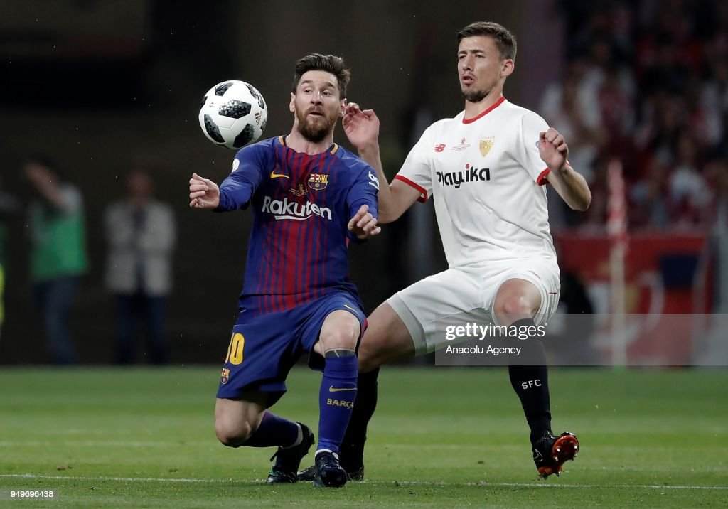 Lionel Messi (L) of Barcelona in action against Clement Lenglet (R) of Sevilla during Copa del Rey Final soccer match between Sevilla and Barcelona at Wanda Metropolitano Stadium in Madrid, Spain on April 21, 2018.