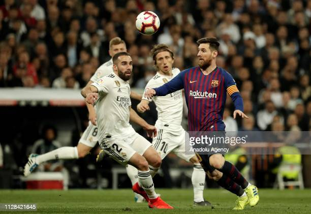 Lionel Messi of Barcelona in action against Dani Carvajal of Real Madrid during the La Liga week 26 soccer match between Real Madrid and Barcelona at...