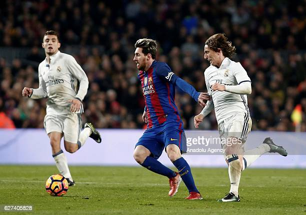 Lionel Messi of Barcelona in action against Luka Modric of Real Madrid during the La Liga football match between FC Barcelona and Real Madrid CF at...