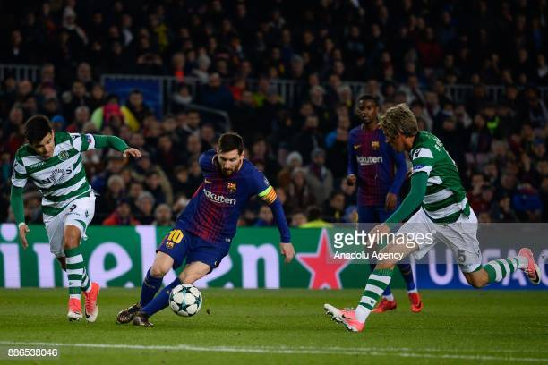 Lionel Messi of Barcelona in action against Marcos Acuna and Fabio Coentrao of Sporting CP during the UEFA Champions League Group C soccer match...