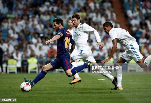 Lionel Messi of Barcelona in action against the Mateo Kovacic of Real Madrid during the Spanish Super Cup return match between Real Madrid and...