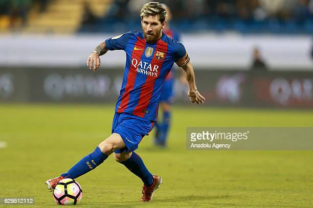 Lionel Messi of Barcelona in action during a friendly soccer match between Al-Ahli Saudi and Barcelona at Al-Gharrafa Stadium in Doha, Qatar on...