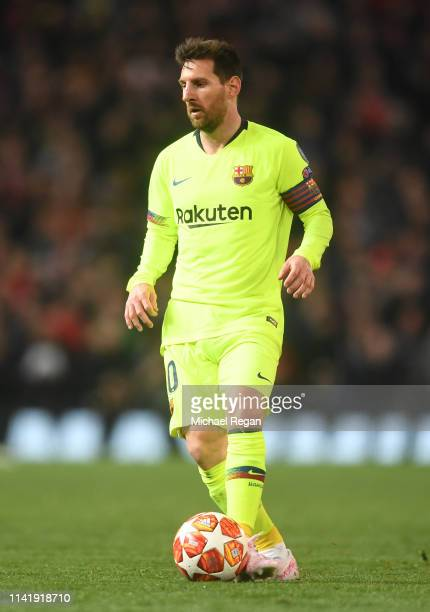 Lionel Messi of Barcelona in action during the UEFA Champions League Quarter Final first leg match between Manchester United and FC Barcelona at Old...