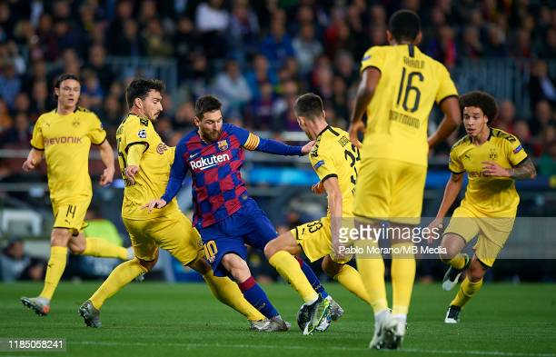Lionel Messi of Barcelona in action surrounded by players of Borussia Dortmund during the UEFA Champions League group F match between FC Barcelona...