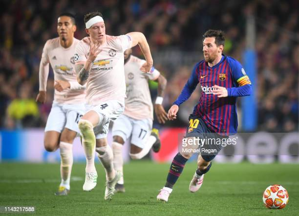 Lionel Messi of Barcelona in action with Chris Smalling and Phil Jones of Manchester United during the UEFA Champions League Quarter Final second leg...
