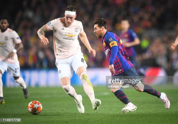 Lionel Messi of Barcelona in action with Phil Jones of Manchester United during the UEFA Champions League Quarter Final second leg match between FC...