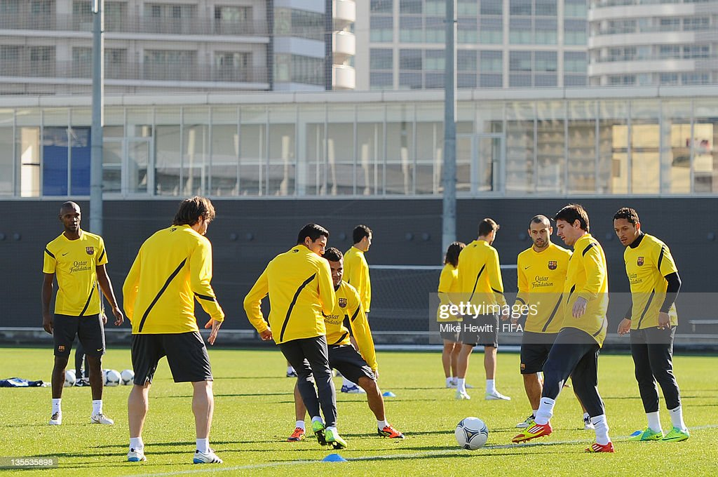 Lionel Messi of Barcelona (2nd R) in action with team mates during the Barcelona training at Marinos Town on December 12, 2011 in Yokohama, Japan.