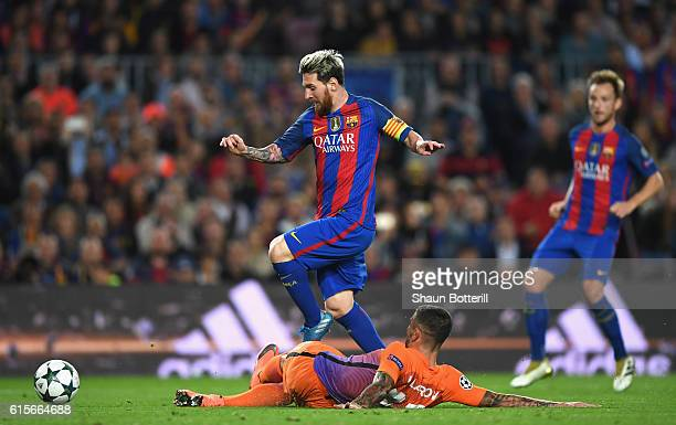 Lionel Messi of Barcelona is bought down in the penalty area by Aleksander Kolorov of Manchester City during the UEFA Champions League group C match...