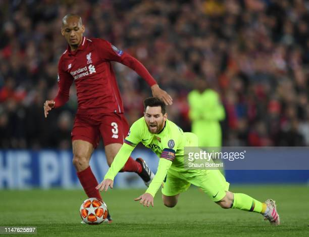 Lionel Messi of Barcelona is brought down by Fabinho of Liverpool during the UEFA Champions League Semi Final second leg match between Liverpool and...