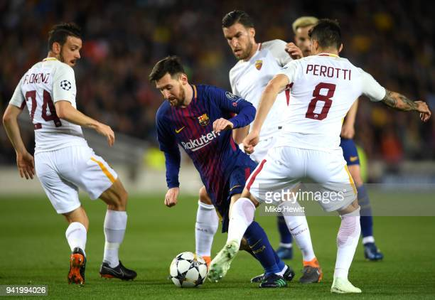 Lionel Messi of Barcelona is challenged by Alessandro Florenzi of AS Roma and Diego Perotti of AS Roma during the UEFA Champions League Quarter Final...