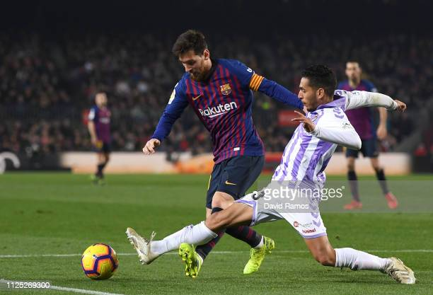 Lionel Messi of Barcelona is challenged by Anuar of Real Valladolid during the La Liga match between FC Barcelona and Real Valladolid CF at Camp Nou...