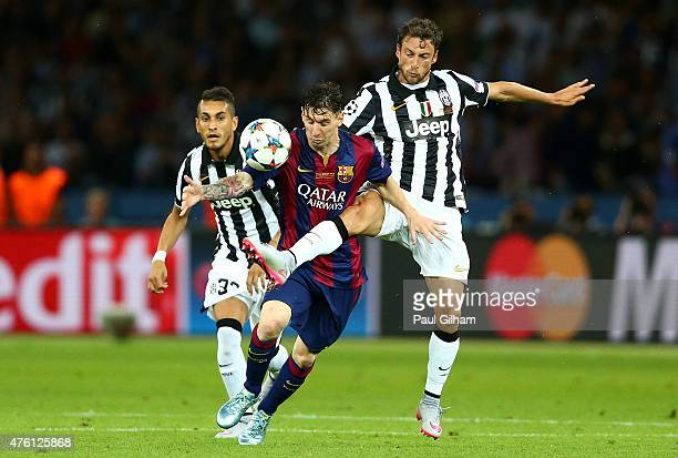 Lionel Messi of Barcelona is challenged by Claudio Marchisio of Juventus during the UEFA Champions League Final between Juventus and FC Barcelona at...
