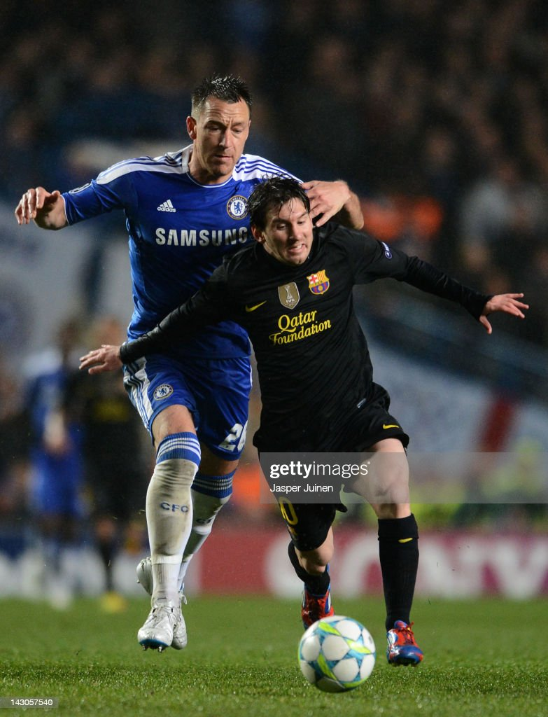 Lionel Messi of Barcelona is challenged by John Terry of Chelsea during the UEFA Champions League Semi Final first leg match between Chelsea and Barcelona at Stamford Bridge on April 18, 2012 in London, England.