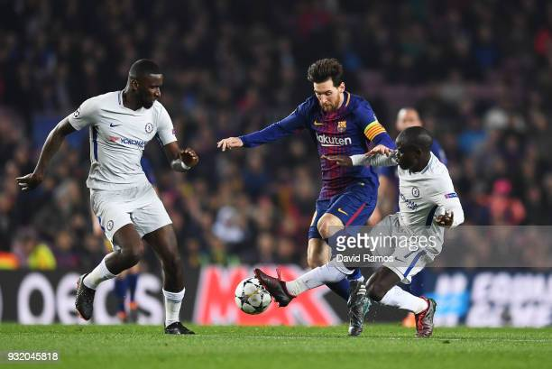 Lionel Messi of Barcelona is challenged by N'Golo Kante of Chelsea and Antonio Rudiger of Chelsea during the UEFA Champions League Round of 16 Second...