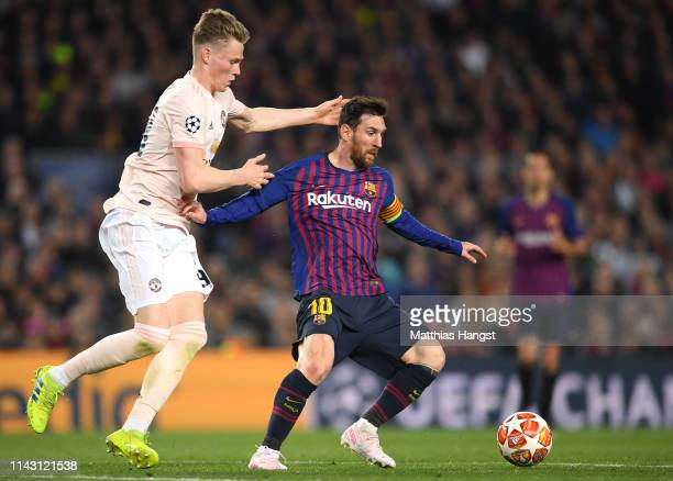 Lionel Messi of Barcelona is challenged by Scott McTominay of Manchester United during the UEFA Champions League Quarter Final second leg match...