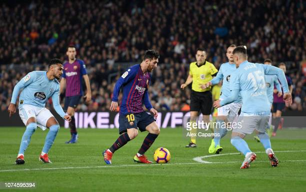 Lionel Messi of Barcelona is challenged by Sofiane Boufal and Robert Mazan of Celta Vigo during the La Liga match between FC Barcelona and RC Celta...