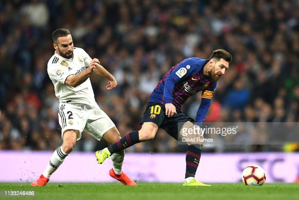 Lionel Messi of Barcelona is closed down by Daniel Carvajal of Real Madrid during the La Liga match between Real Madrid CF and FC Barcelona at...