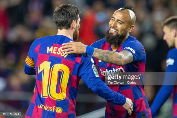 Lionel Messi of Barcelona is congratulated by Arturo Vidal of Barcelona after scoring from the penalty spot during the Barcelona V Real Sociedad La...