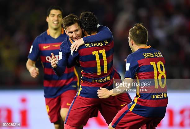 Lionel Messi of Barcelona is congratulated by Luis Suarez Neymar and Jordi Alba of Barcelona after scoring the opening goal during the FIFA Club...