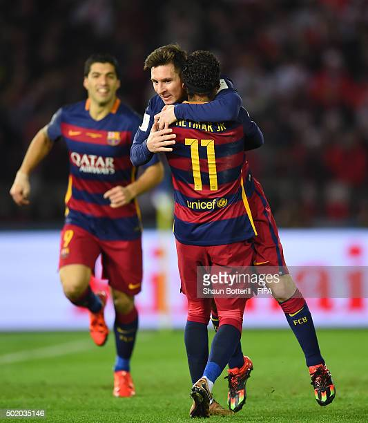 Lionel Messi of Barcelona is congratulated by Neymar of Barcelona after scoring the opening goal during the FIFA Club World Cup Final between River...