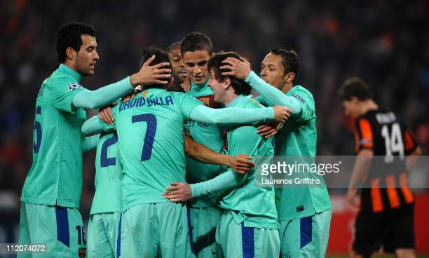 Lionel Messi of Barcelona is congratulated on scoring the opening goal during the UEFA Champions League Quarter Final 2nd Leg match between Shakhtar...