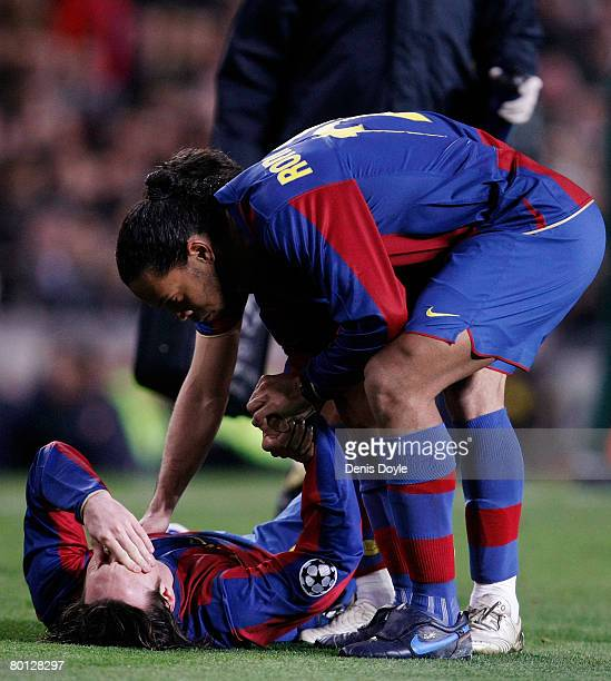 Lionel Messi of Barcelona is consoled by teammate Ronaldinho after getting injured during the UEFA Champions League 2nd leg of the First knockout...