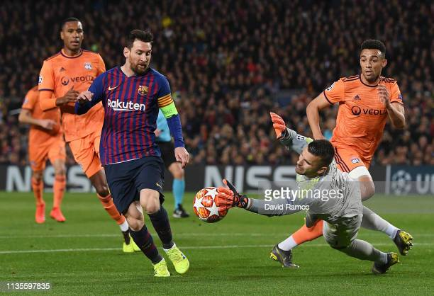 Lionel Messi of Barcelona is foiled by Anthony Lopes of Olympique Lyonnais during the UEFA Champions League Round of 16 Second Leg match between FC...
